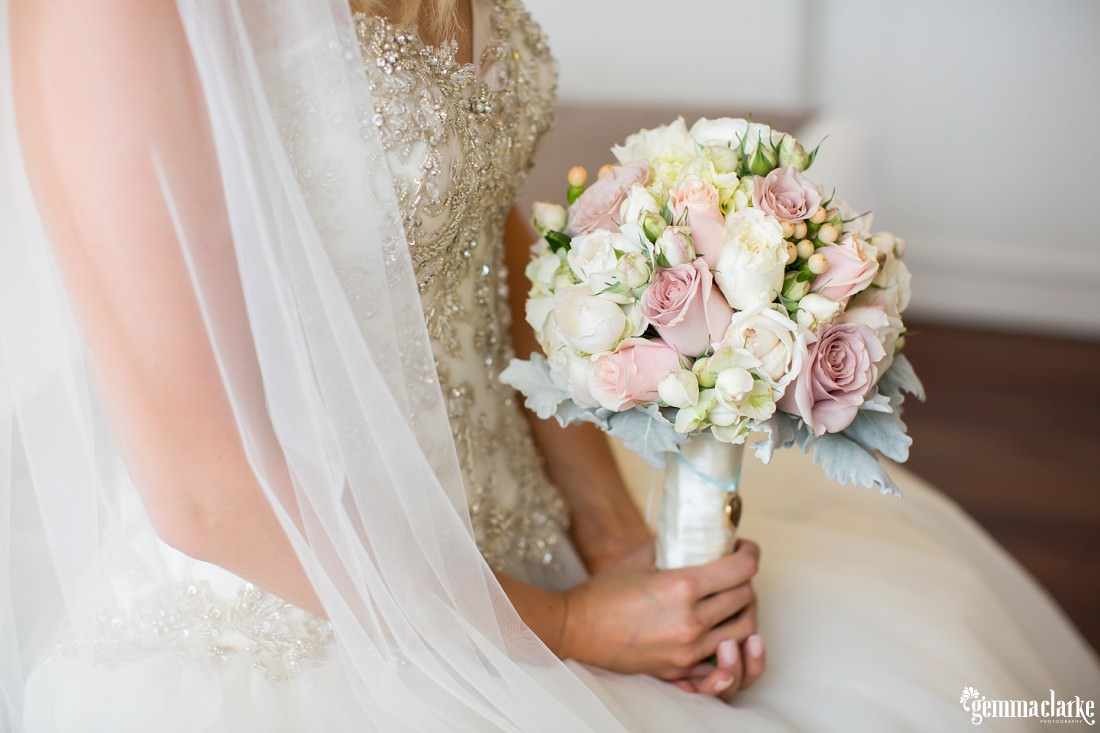 A closeup of a bride's bouquet