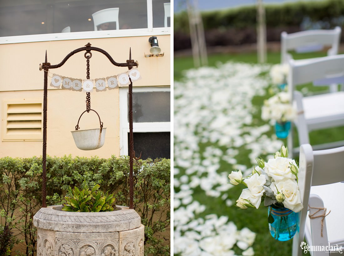"Floral decorations on chairs along the aisle and a wishing well with a ""Mr & Mrs"" sign hanging above it"