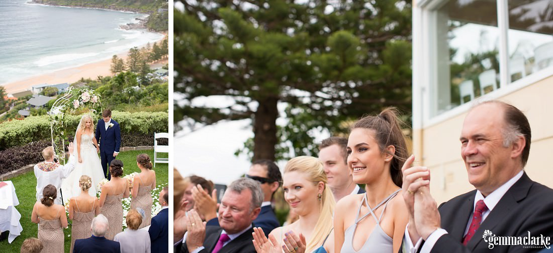 Wedding guests clap as a bride and groom are announced as man and wife