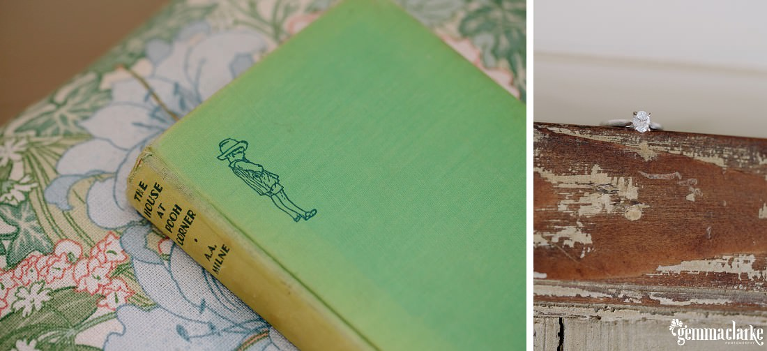 "A diamond ring on a wooden beam and a green coloured book titled ""The House At Pooh Corner"" by A. A. Milne"