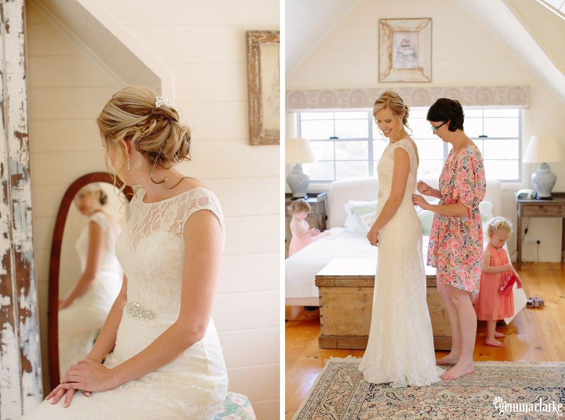 A bride having the back of her dress laced up by her maid of honour, and the bride sitting and looking in a mirror