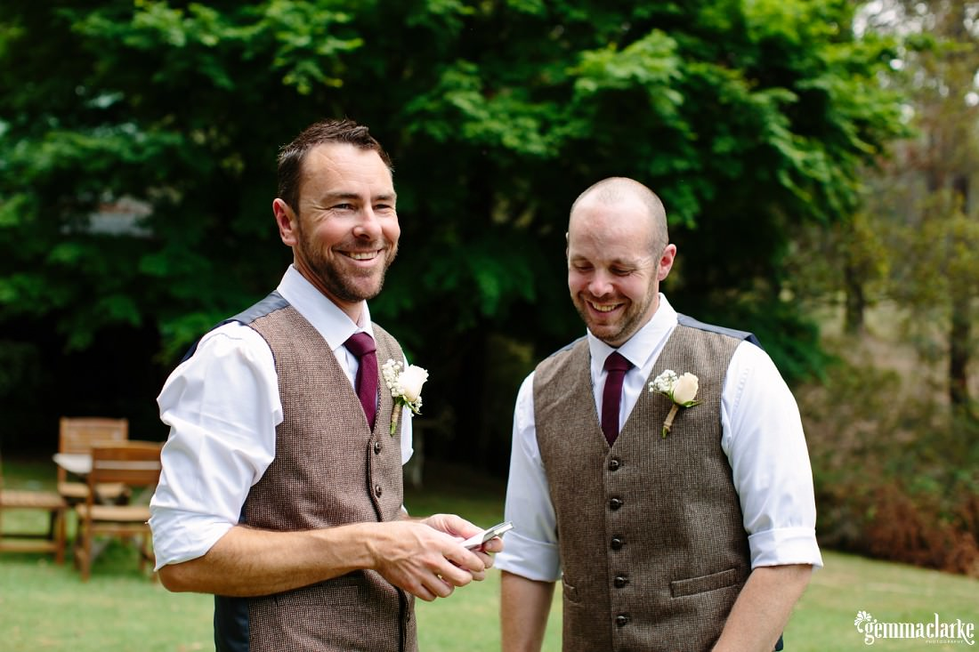 A groom and his best man smiling together