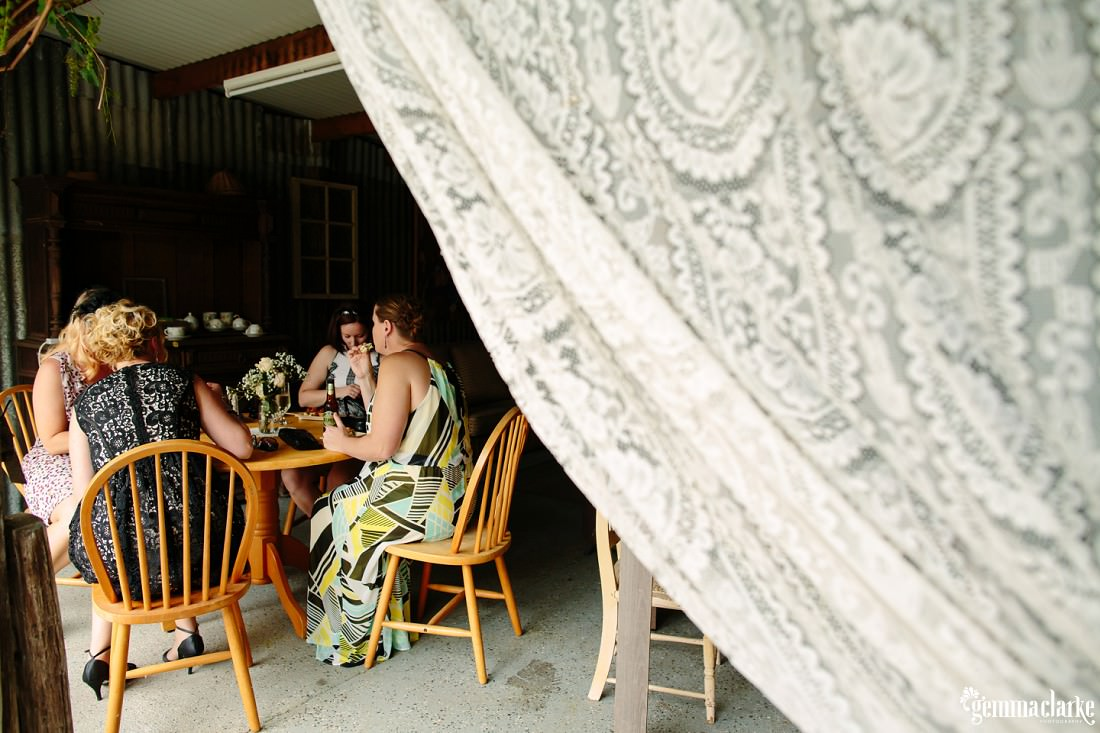 Some wedding guests sitting around a wooden table