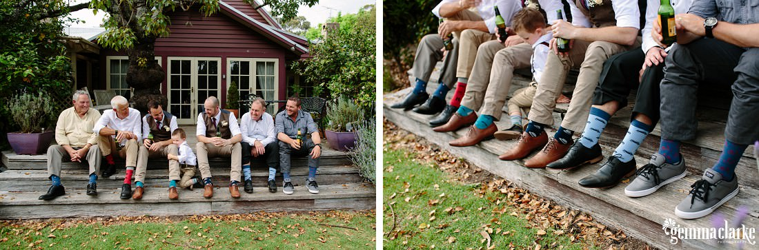 The groom, his son and his best man and a few other male wedding guests sitting along some wooden steps