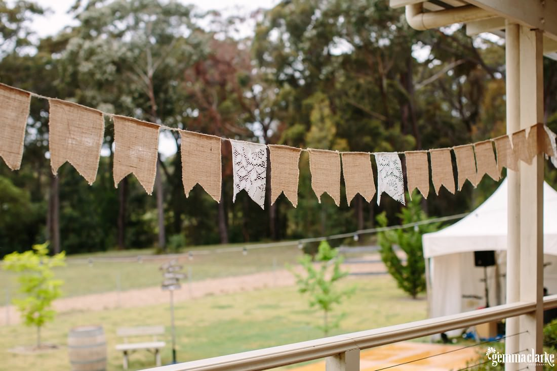Hessian and lace bunting hanging on a verandah