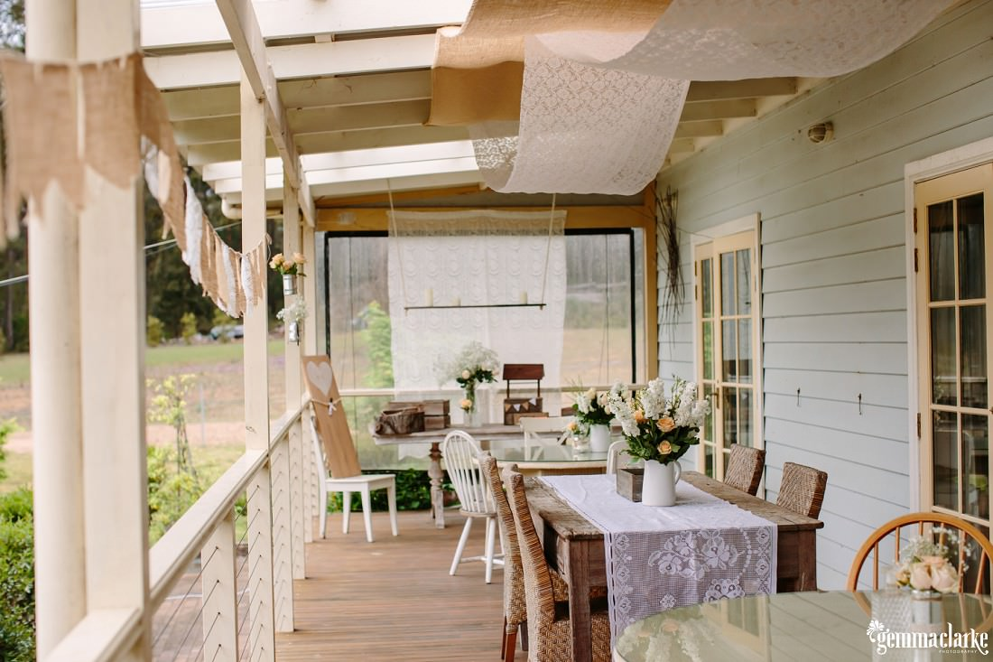 A wedding reception setup on a cottage verandah