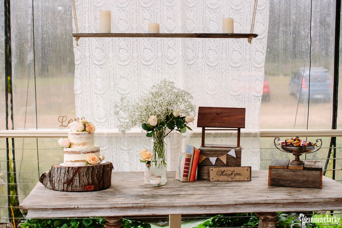 Wedding cake and other decorations on a wooden table