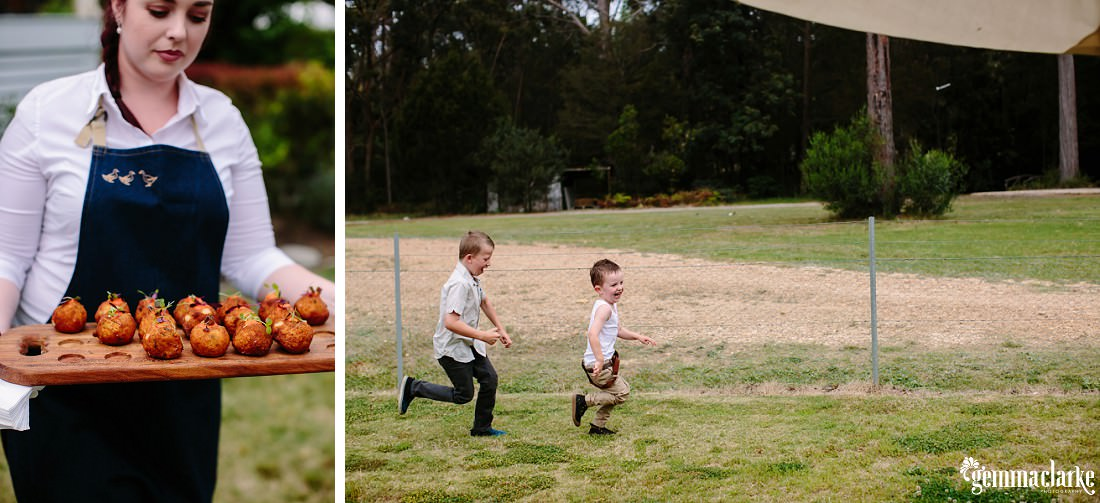 Food being served and two young boys chasing each other across a yard