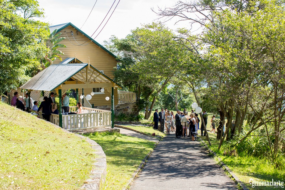 Wedding guests mingling outside Athol Hall