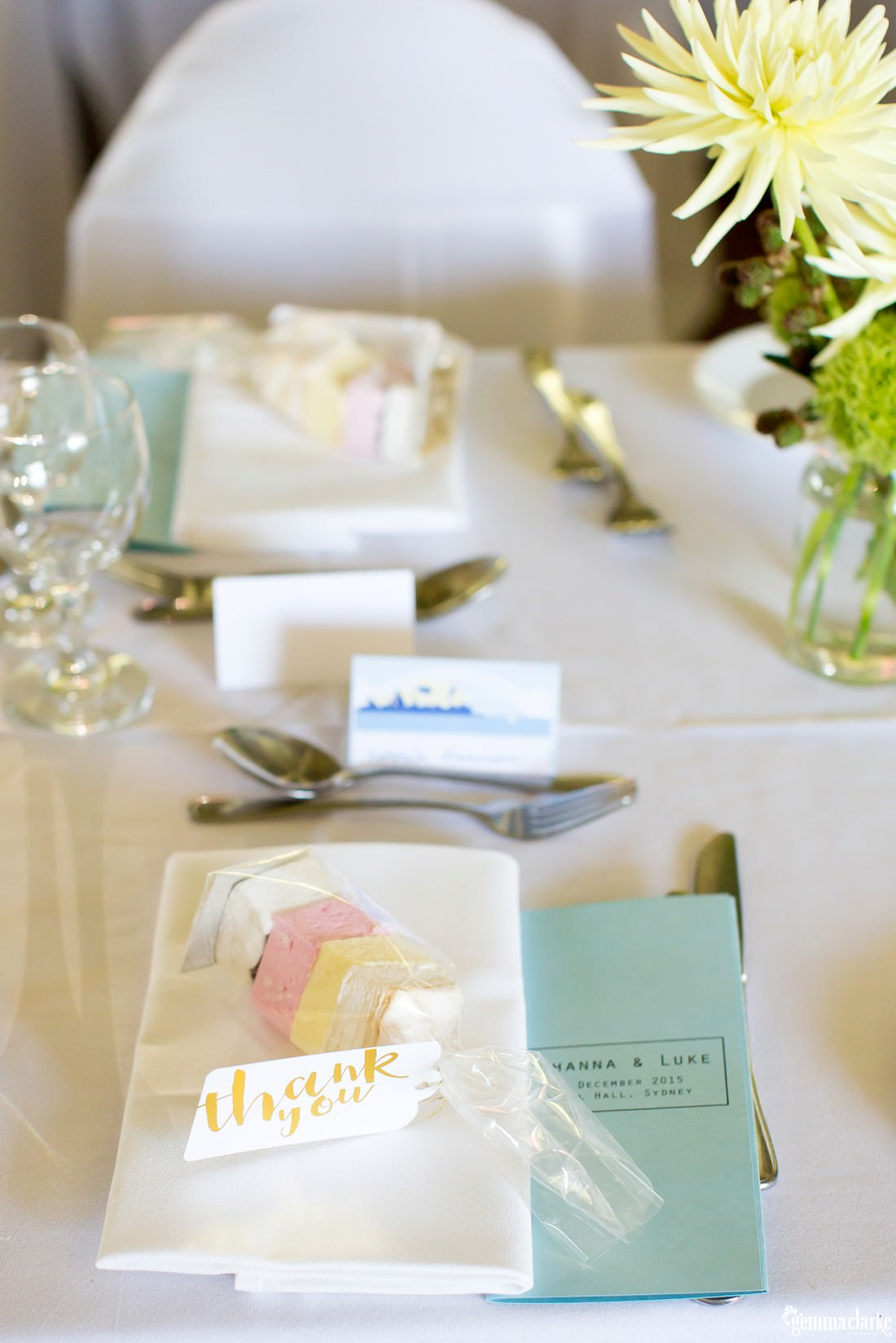 Table settings with a thank you gift at a wedding reception