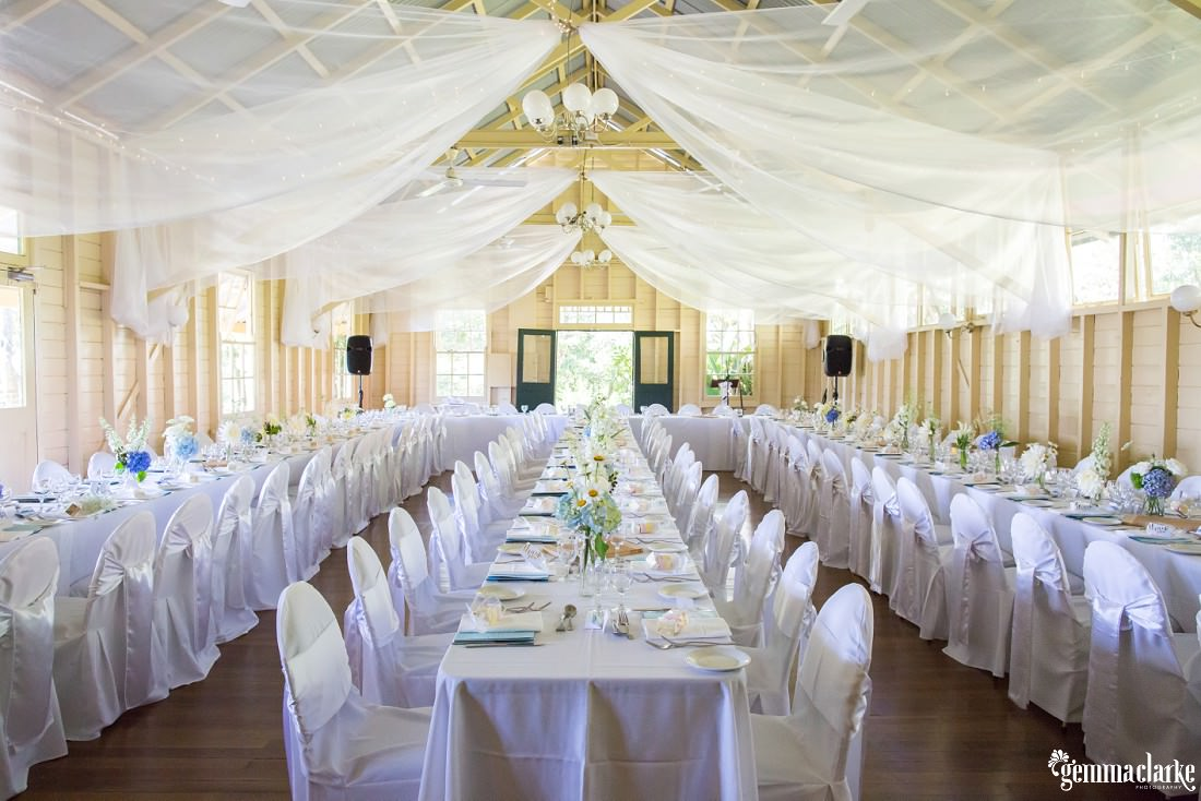 White tables and chairs setup in Athol Hall