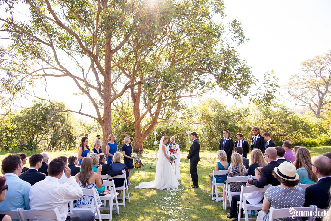 An overall shot of an outdoor wedding ceremony