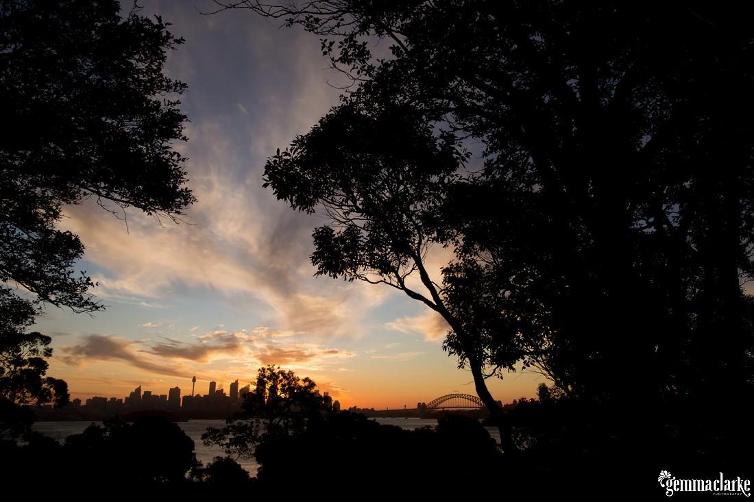 The sun setting behind Sydney