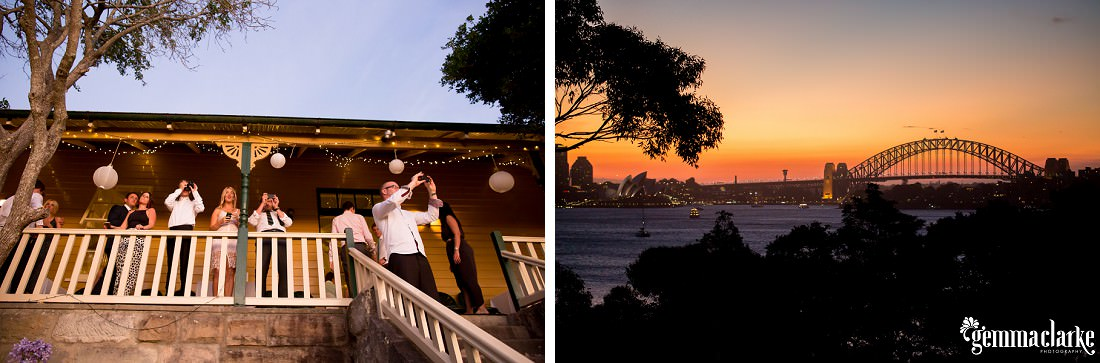 Wedding guests taking photos of the Sydney sunset from the balcony of Athol Hall
