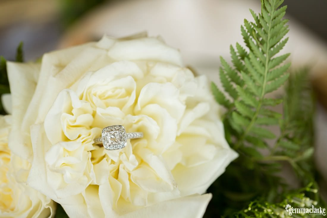 An engagement ring in a flower