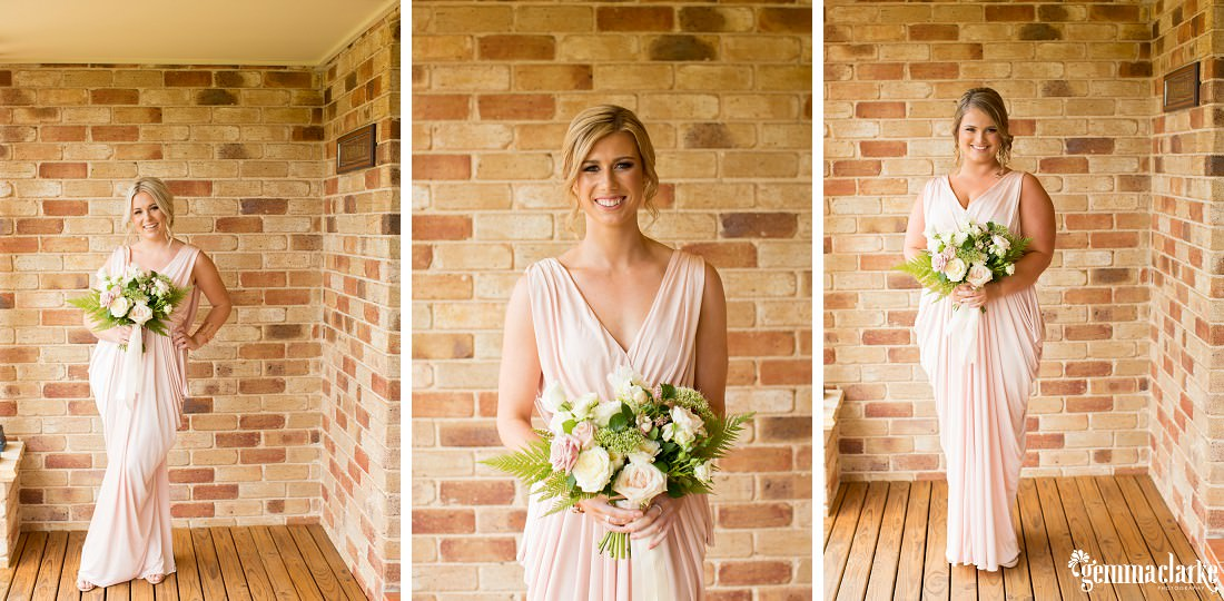 Three smiling bridesmaids in blush pink gowns holding lightly coloured floral bouquets