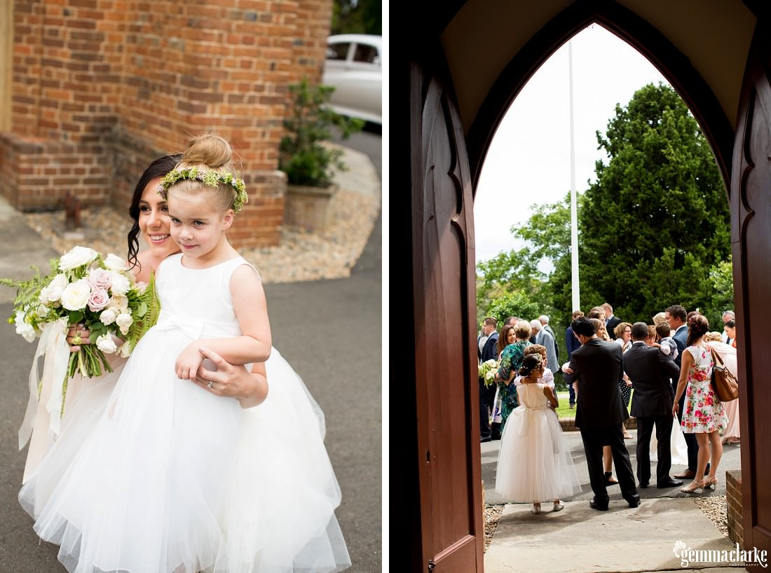 A bride and groom are congratulated by wedding guests outside a church