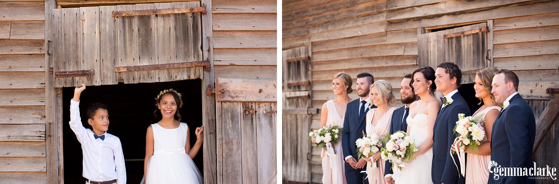 A smiling bridal party standing in front of a wooden farm building and a junior bridesmaid making a funny face