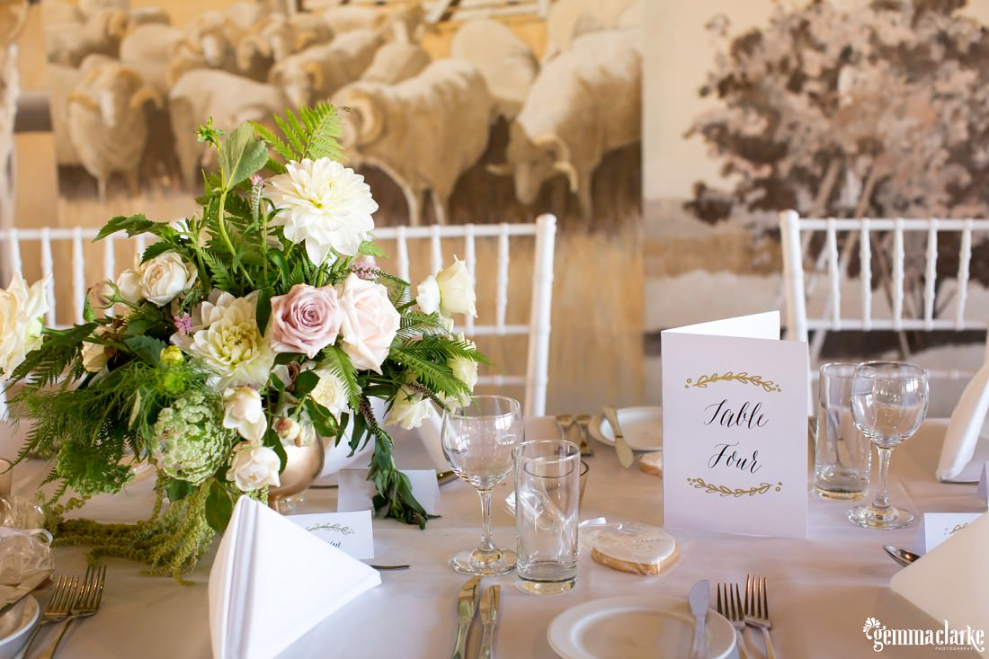 Table settings and floral decorations at a wedding reception