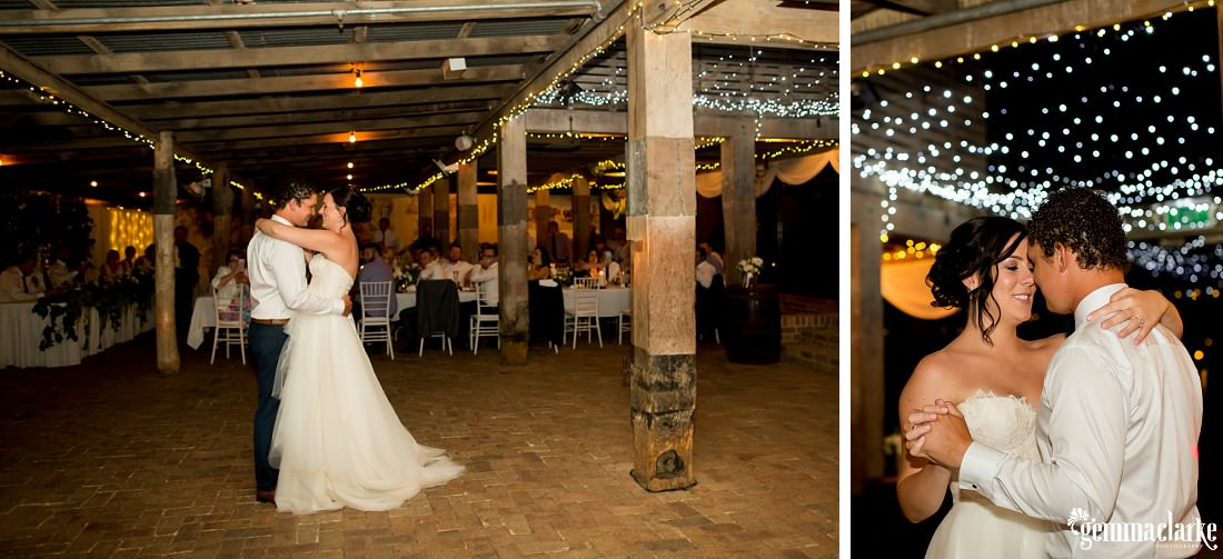 A bride and groom share their first dance at their wedding reception under fairy lights