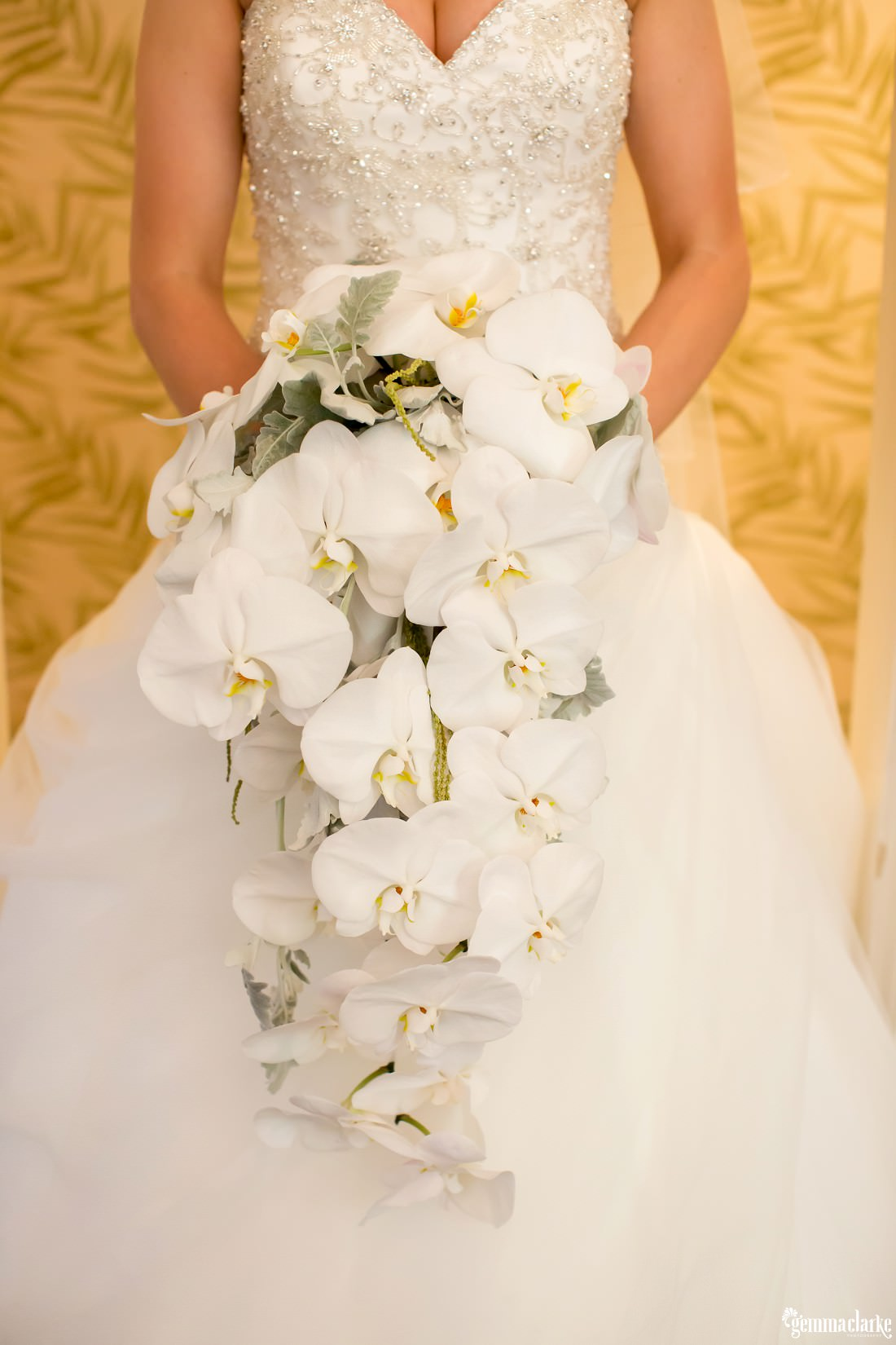 A bridal bouquet of lovely white orchids - Maroubra Beach Wedding