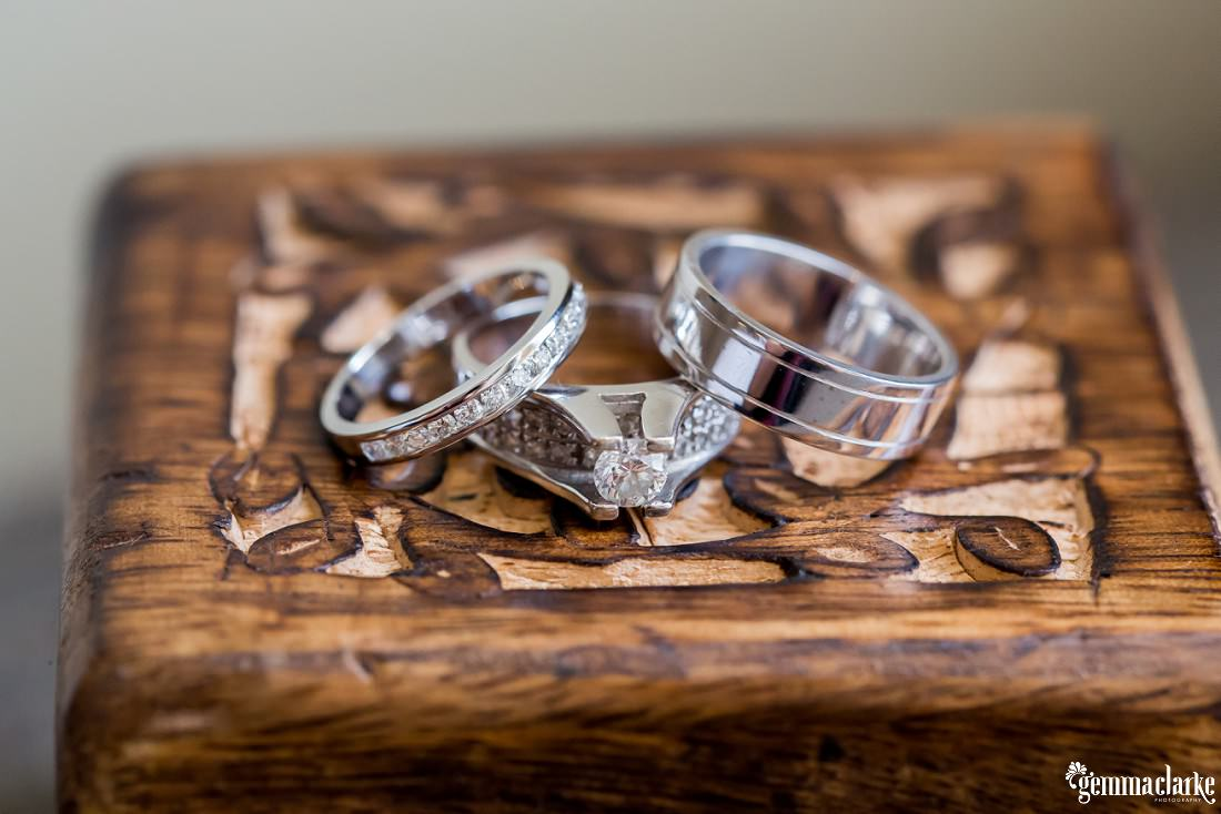 White gold rings on a wooden box