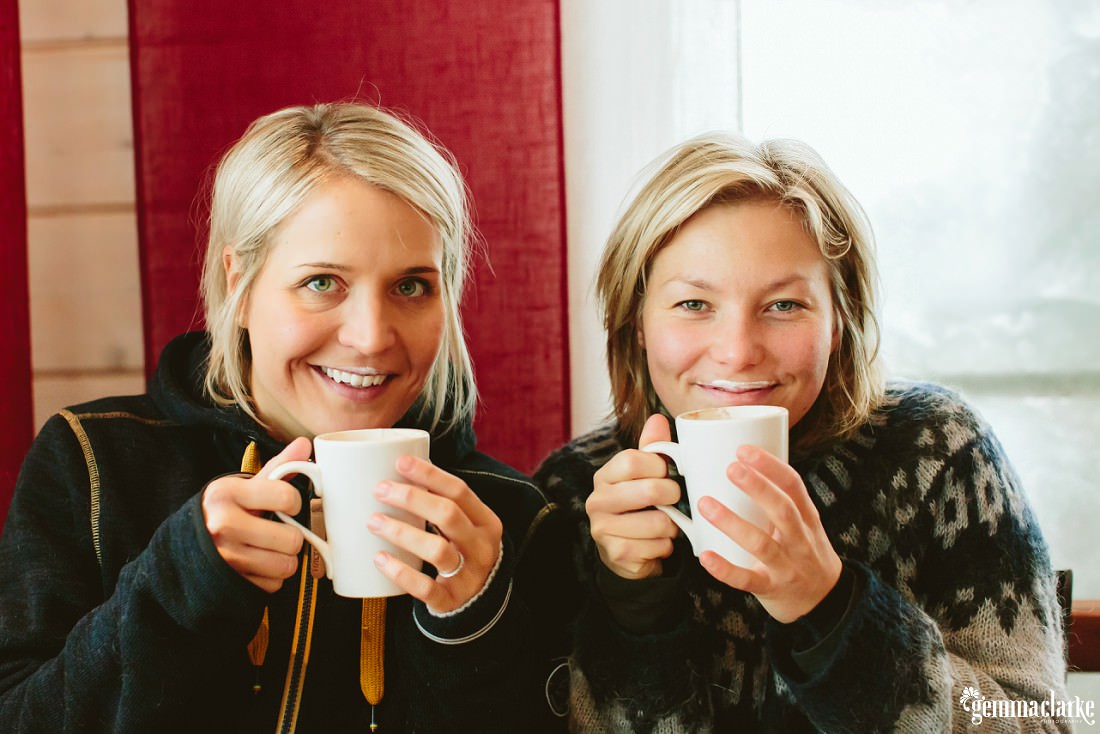 "A couple holding mugs of coffee and showing their ""milk moustaches"""