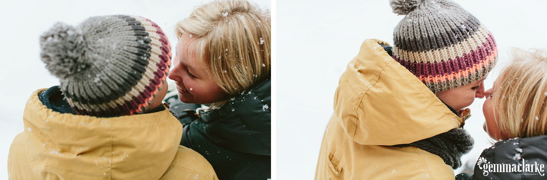 A couple sharing eskimo kisses in the snow