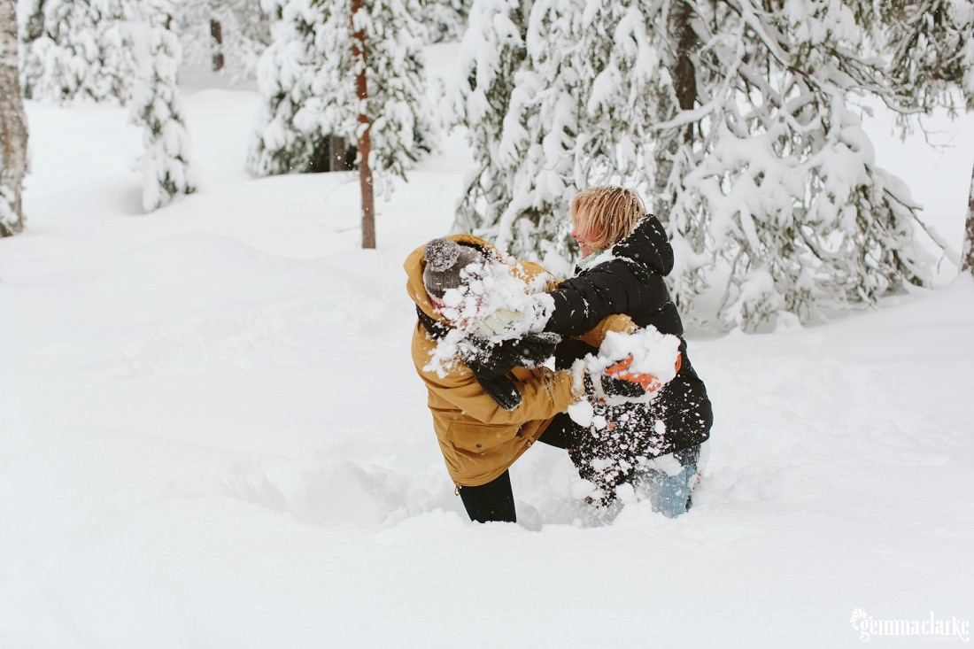 A couple playing in deep snow