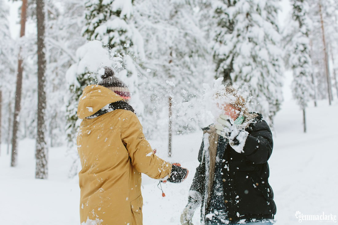 A couple having a snowball fight