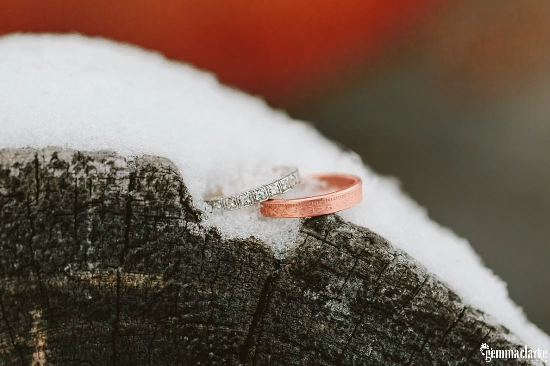 Two rings on a snow covered log