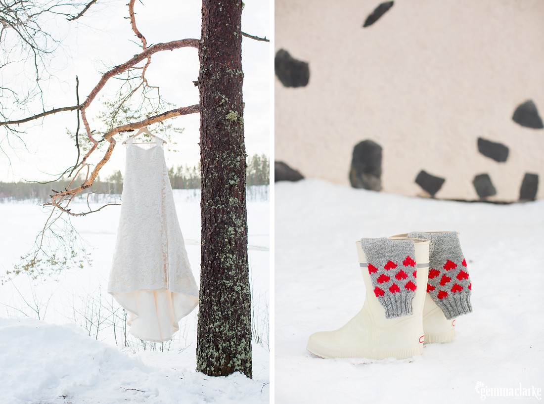 A white lacy wedding dress hanging from a tree in a snowy field, grey socks covered in red love hearts hanging out of white boots in the snow