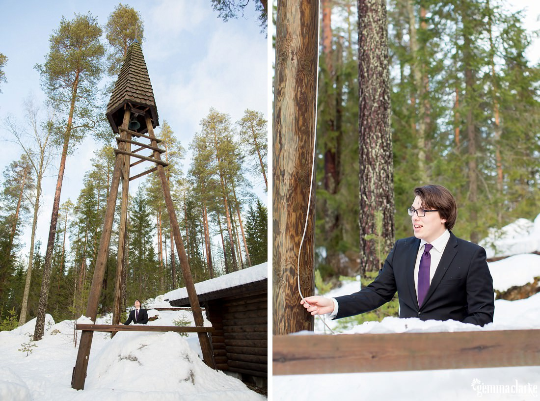 A man rings a bell at an outdoor chapel in the snow