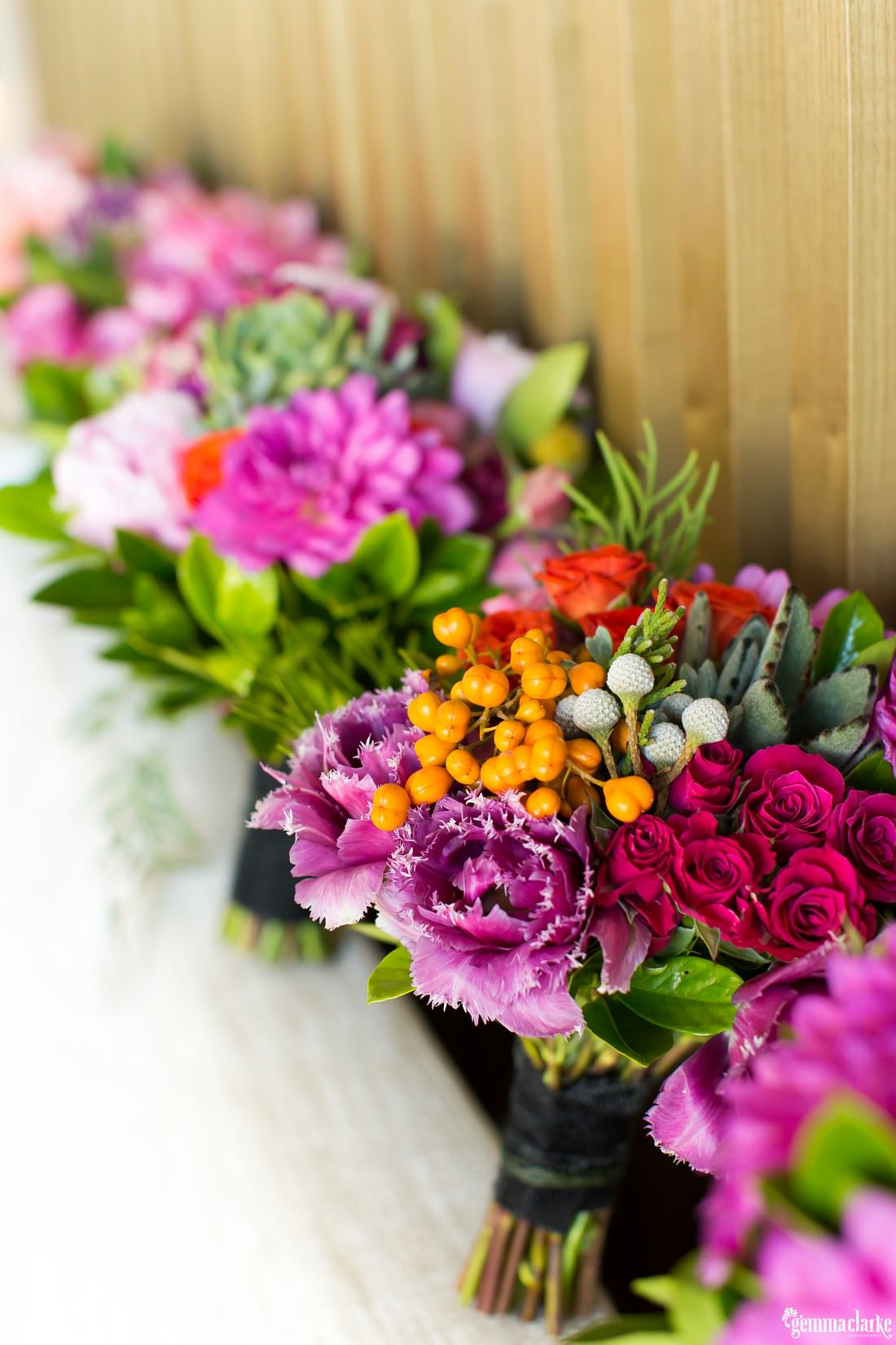 A closeup of some bouquets of pink and purple flowers