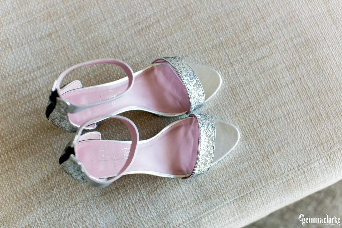 A top down view of a pair of silver and pink bridal shoes