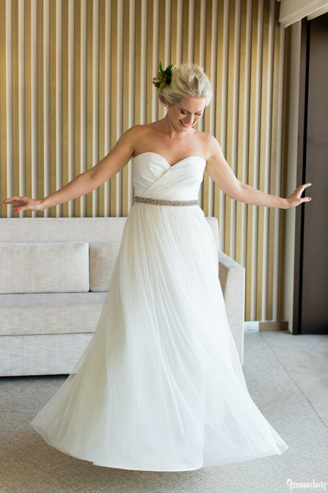 A bride twirling her wedding gown