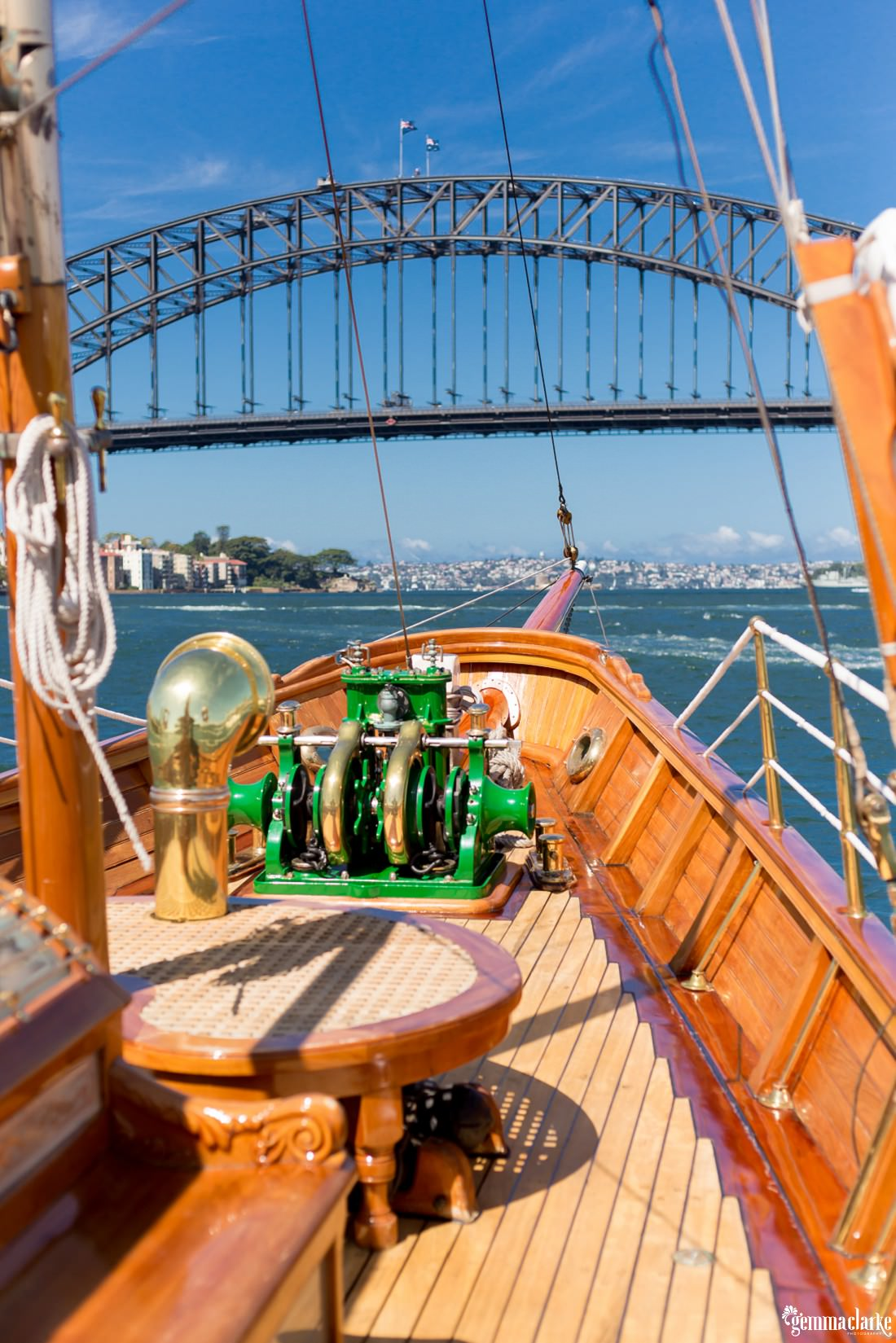 Sydney Harbour from the front of a boat that is about to pass underneath the Sydney Harbour Bridge