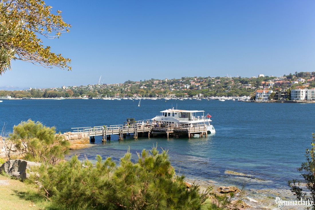 A boat docked at Shark Island on Sydney Harbour