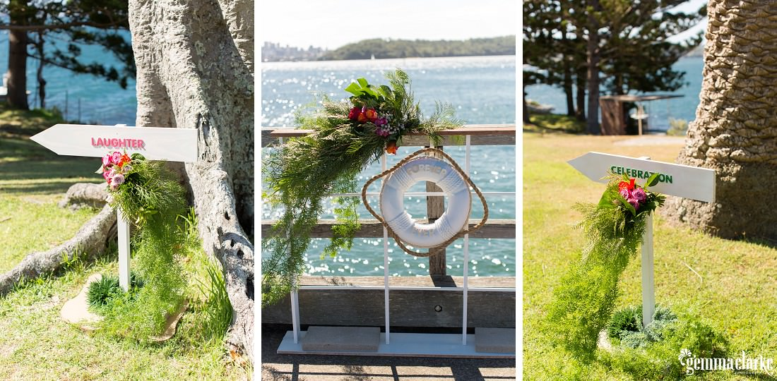 Weddings signs and floral decorations on pier and in park