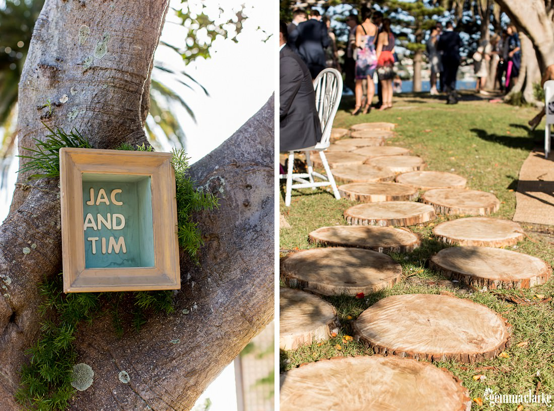 "Wooden tree ""stepping stones"" and a frame with the bride and groom's names in it"