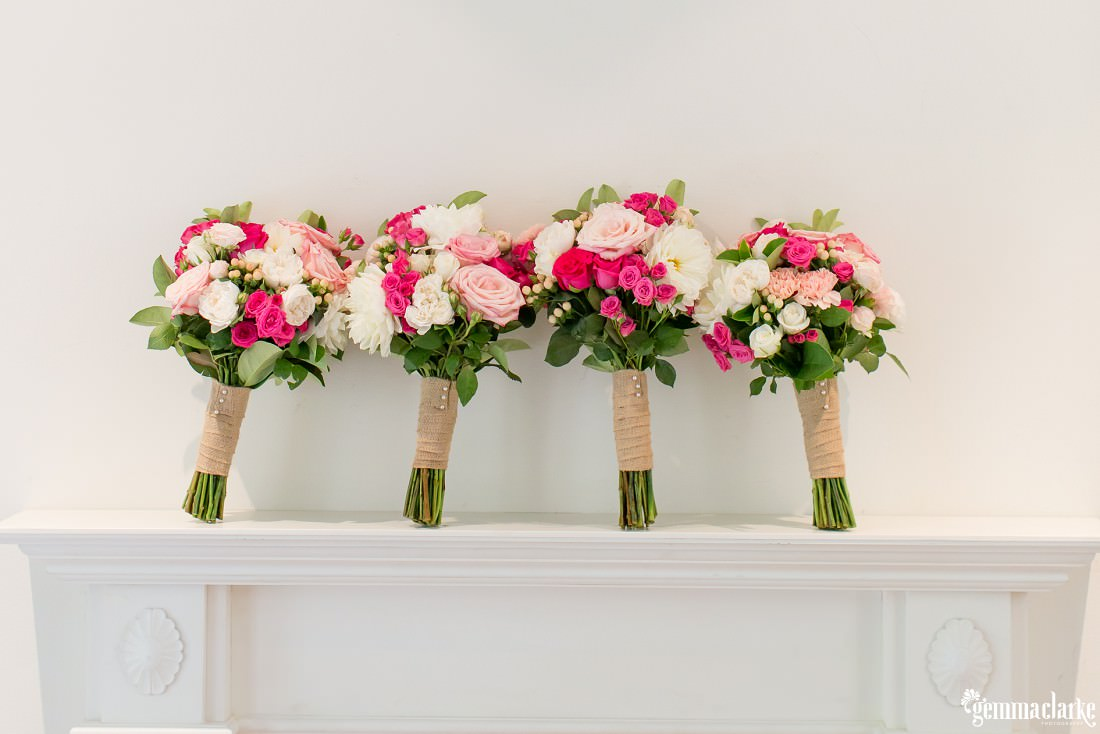 Four wedding bouquets of white and pink flowers