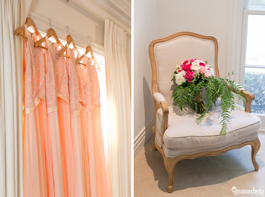 Four peach coloured bridesmaids dresses hanging up and a bridal bouquet on a chair