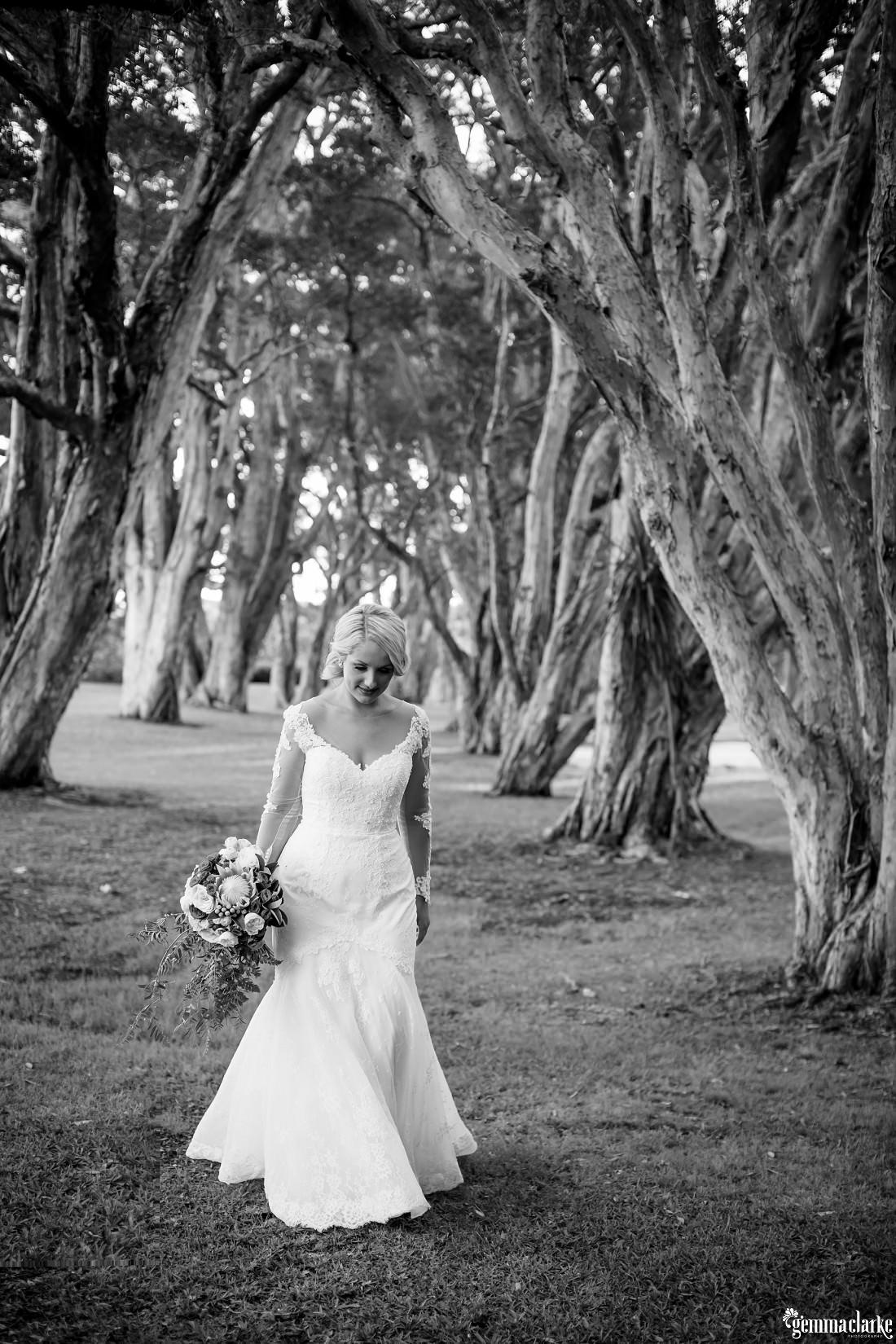 A bride walking through some trees - Centennial Park Wedding