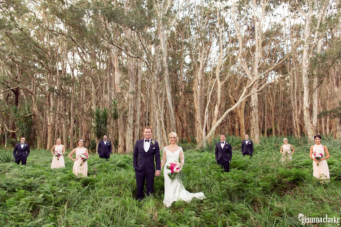 A bridal party standing in a forest - Centennial Park Wedding