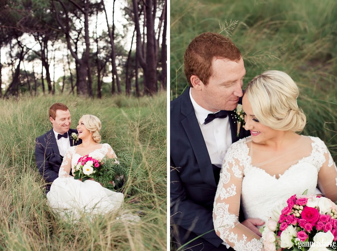 A happy bride and groom lay back together in long grass - Centennial Park Wedding