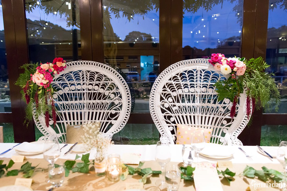 The bride and groom's seats at their wedding reception