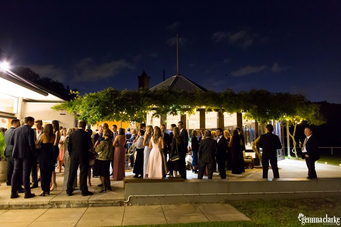 Wedding guests standing outside the reception venue