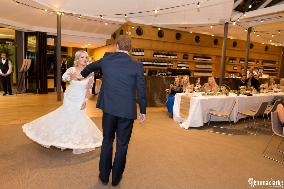 A bride and groom share their first dance at their wedding reception