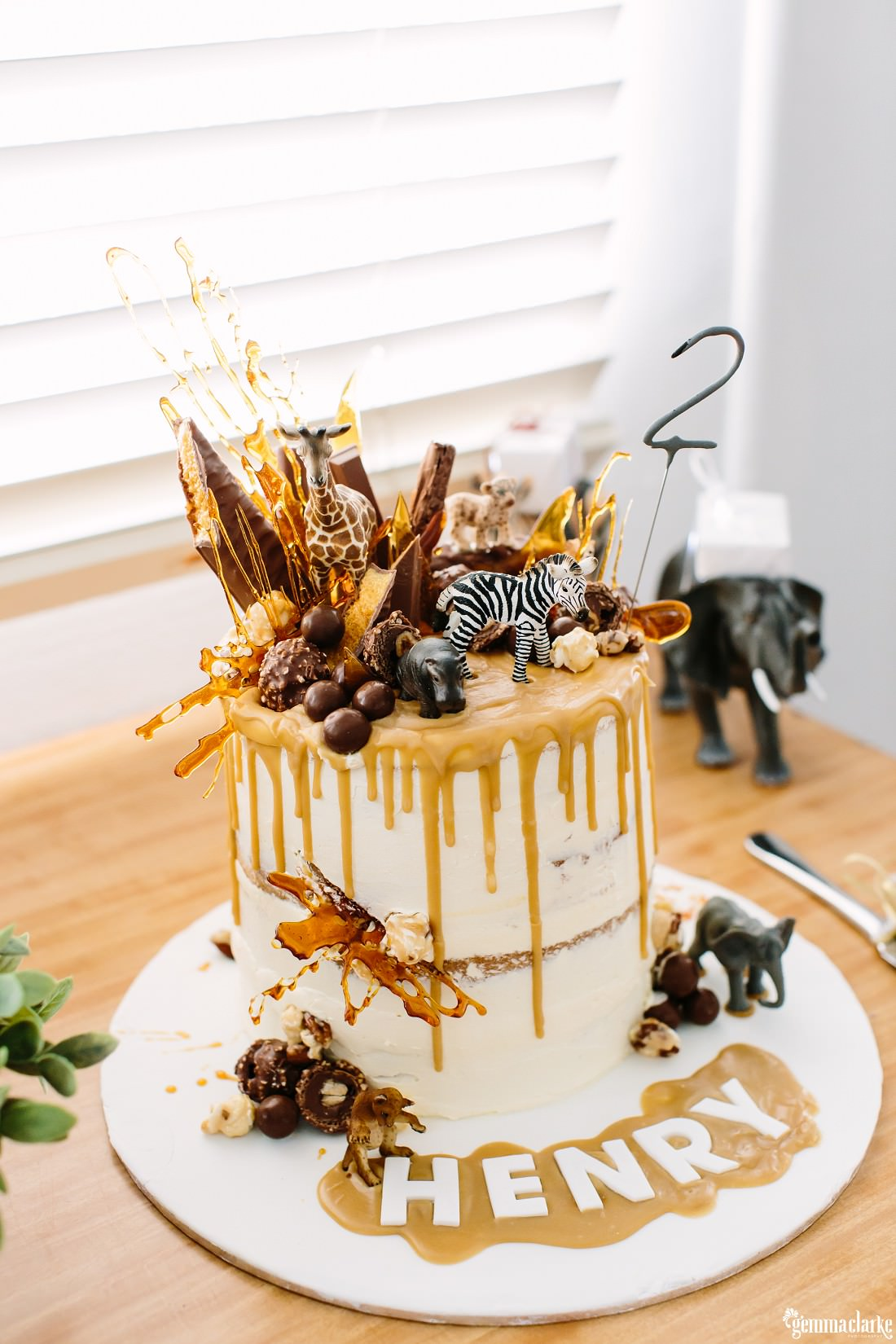 Amazing Naked Cake With Caramel Dripping From The Top And Covered In Chocolate Bars Toy