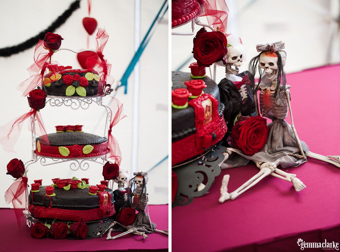 A black and red cake with skeleton bride and groom and deep red roses - Friday the 13th Wedding